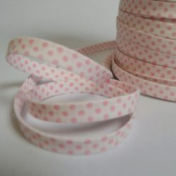 Biais replié 9mm en coton, motif pois roses fond blanc (au mètre)
