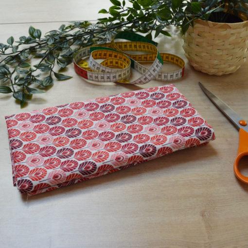 Tissu coton imprimé enfant plumes rouges